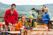 Young caucasian friends relaxing mountain countryside view summer sport