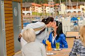 picture of say goodbye  - Woman saying goodbye to her friends at outdoor restaurant terrace - JPG