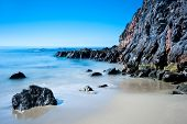 A peaceful image of shoreline scenery in Laguna Beach California.  Image shot to capture the motion