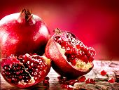 stock photo of wood pieces  - Pomegranate fruit - JPG