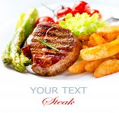 Grilled Beef Steak Meat with Fried Potato, Asparagus and Cherry Tomato. Steak Dinner. Food