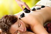 Spa Stone Massage. Beautiful Woman Getting Spa Hot Stones Massage in Spa Salon. Beauty Treatments Outdoor. Nature