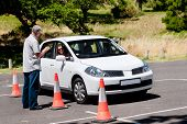 stock photo of seatbelt  - Learner driver girl with instructor taking lessons - JPG