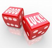 The words Good Luck on two red dice to encourage you to have good fortune and a favorable outcome in