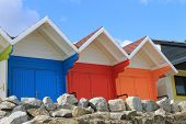 Row of colorful beach chalets at seaside, Scarborough, England.