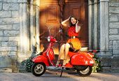 stock photo of vespa  - Vintage image of young attractive girl and old scooter - JPG
