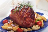 Roasted christmas ham served with healthy vegetables