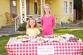 Children Running Charity Bake Sale