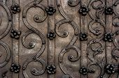 stock photo of ironworker  - Old elegant ornate metal door closeup photo - JPG