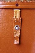 metal lock old orange leather briefcase