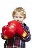 Young Boy Wearing Boxing Gloves Smiling