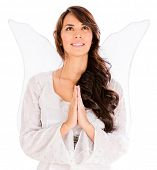 Woman dressed as an angel and praying - isolated over white