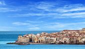 foto of shoreline  - Houses along the shoreline in Cefalu - JPG