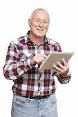 Senior Man Using Tablet Computer Smiling