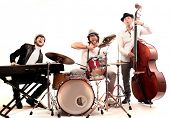 stock photo of ironic  - band of musicians with instruments - JPG