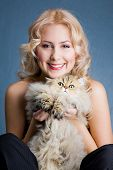 Beautiful blonde smiling woman with fluffy cat