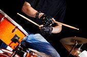 Man playing  drum in night club.