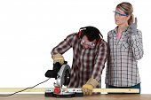 Couple with a circular saw