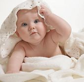stock photo of baby toddler  - little child baby closeup portrait under towel - JPG