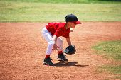 stock photo of ball cap  - Little league short stop in ready position.