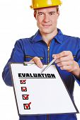 Construction worker holding evaluation checklist and asking for an opinion
