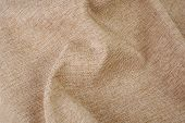 Beige wrinkly textile material woven cloth