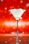 margarita  cocktail glitter red golden background, shallow dof