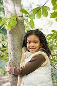 Girl holding tree