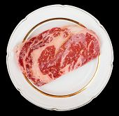 Premium quality kobe beef ribeye steak in plate isolated on black with clipping path