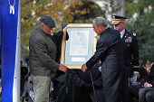 Presenting Mayor Bloomberg with gift from veterans assoc.