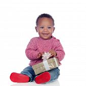 Adorable African American child playing with a gift box isolated on a white background