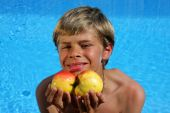 Boy Presenting Apples In Summer Sun
