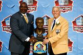 CANTON, OH-AUG 3: Former NFL player George Martin (L) and Bill Parcells pose with his bust during th