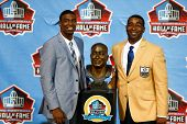 CANTON, OH-AUG 3: Duron Carter (L) and father and former receiver Cris Carter pose with his bust at