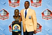 CANTON, OH-AUG 3: Former Minnesota Vikings receiver Cris Carter poses with his bust during the NFL C