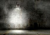 image of lamp shade  - Background image of dark wall with lamp above - JPG