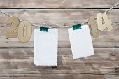 two thousand fourteen New Year number decoration hanging on rope