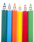 Happy group of pencil faces as social network isolated on whit