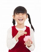 Happy Little Girl Save Money With Piggy Bank