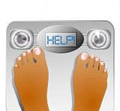 woman's feet weighting themselves on a scale