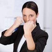 Feisty Business Woman Making A Fist