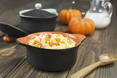 stock photo of millet  - Millet porridge with pumpkin and milk in a pot on the table