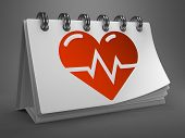 Desktop Calendar with Icon of Heart Cardiogram.
