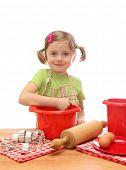 Little girl baking cakes isolated on white background