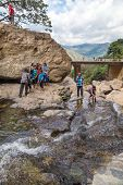 RAVANA FALLS, SRI LANKA - MARCH 2, 2014: Local tourists at Ravana falls, popular sightseeing attract