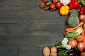 stock photo of farmers  - Vegetables on wood background with space for text - JPG