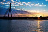 Sunset bridge river Daugava Riga