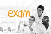 The word exam against scientists working in laboratory