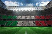 Digitally generated italian national flag against large football stadium