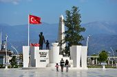 FETHIYE, TURKEY - APRIL 1, 2014: People go toward the monument to Ataturk. The founder of Republic o